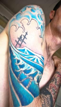 Fantastic Blue Wave Tattoo On Half Sleeve