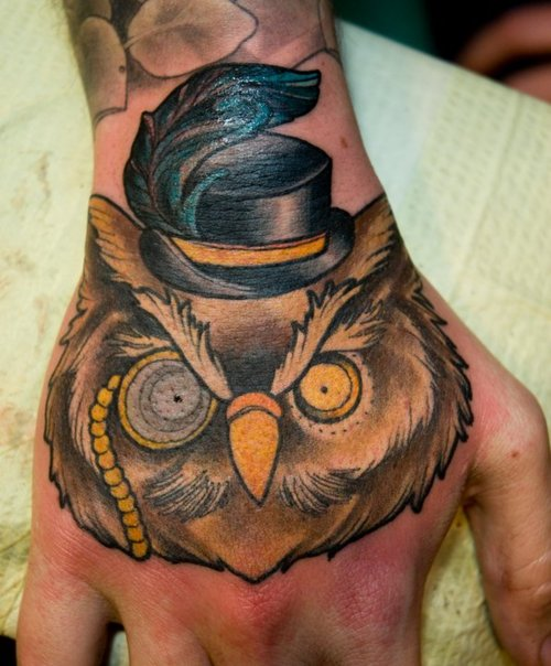 Feather Hat On Owl Tattoo