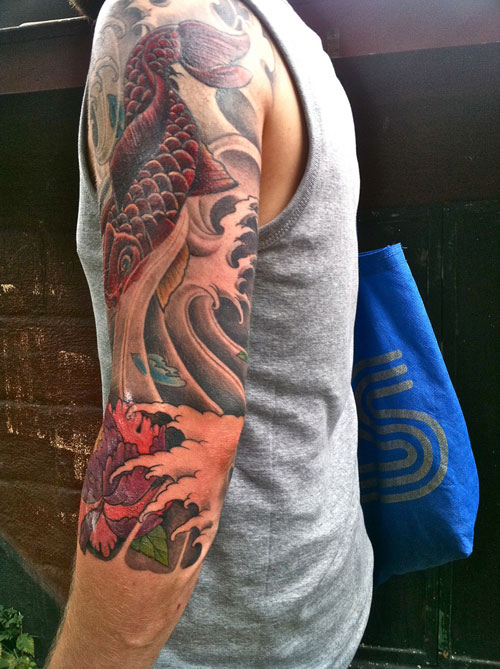 Fish And Wave Tattoos On Sleeve