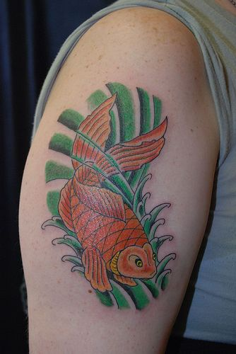 Fish In Green Wave Tattoos On Biceps