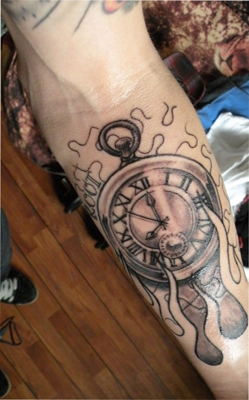 Flames And Clock Tattoos On Forearm