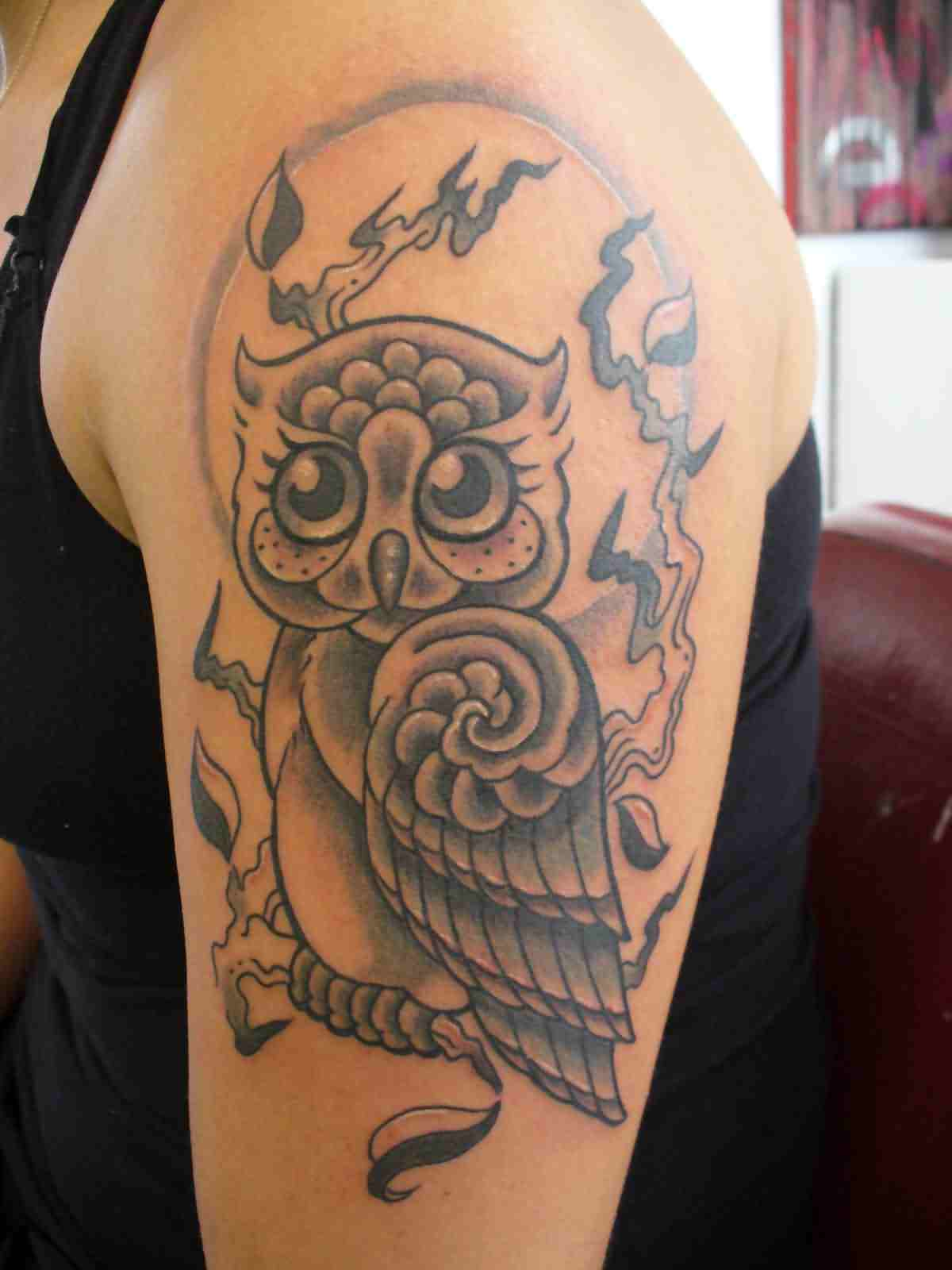 Flames And Owl Tattoos On Arm