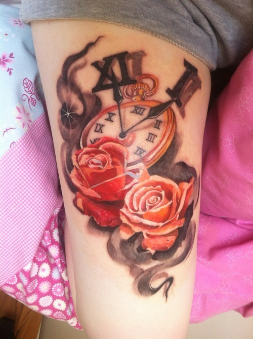 Flames Clock And Rose Tattoos On Thigh