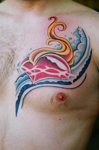 Flaming Heart And Wave Tattoos On Chest For Men