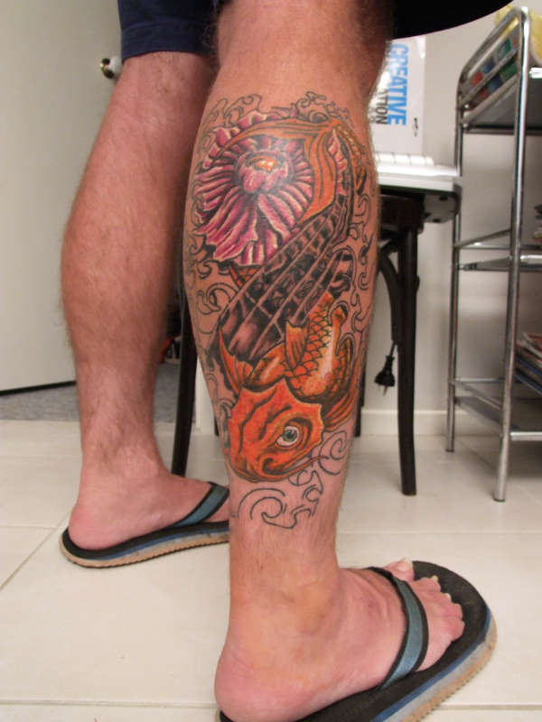 Flower Fish And Wave Tattoos On Right Leg