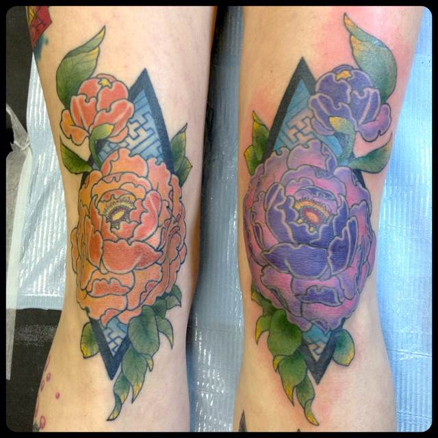Flowers And Triangle Tattoos On Arm