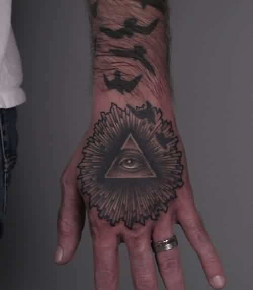 Flying Birds And Triangle Eye Tattoos On Hand