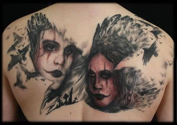 Flying Crows And Portrait Tattoos On Back
