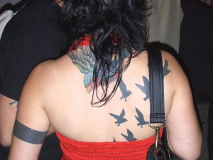 Flying Swallow And Crows Tattoos On Back