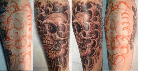 Freehand Skull Wave Tattoos