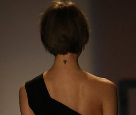Freja Beha's Back Neck Triangle Tattoo