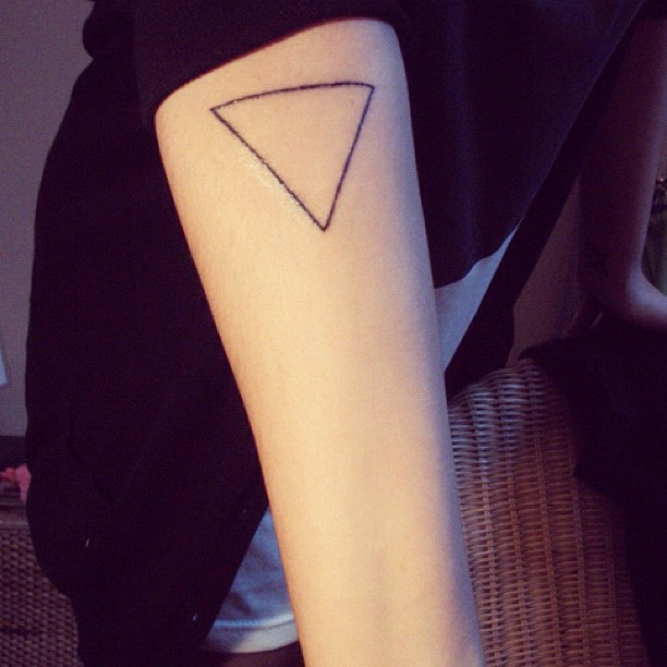 Fresh Black Ink Triangle Tattoo On Arm