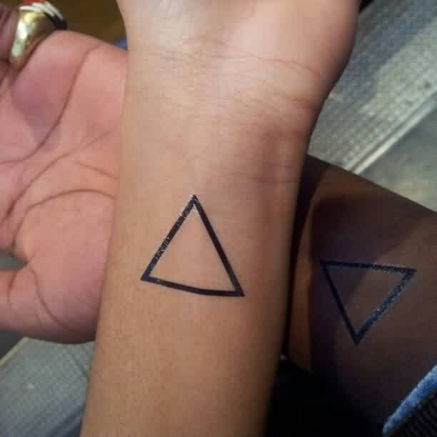 Fresh Black Outline Triangle Tattoo On Wrist