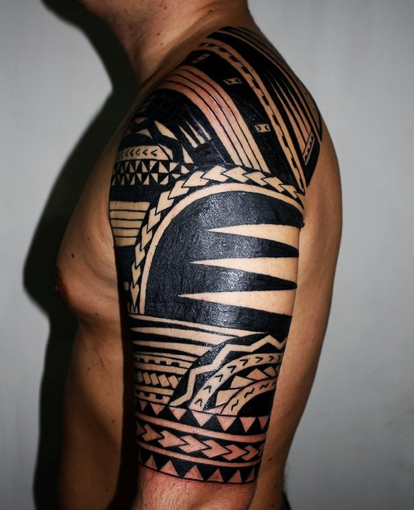 Fresh Black Polynesian Half Sleeve Tattoo