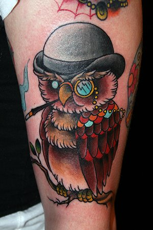 Fresh Brown Owl Wearing Owl Tattoo