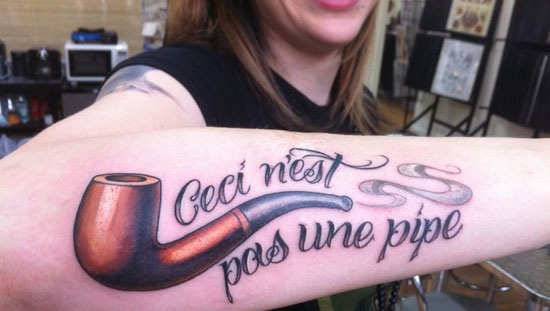 Girl Gets New 3D Smoking Pipe Tattoo On Arm