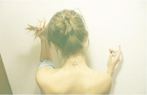 Girl Shows Off Her Back Neck Small Triangle Tattoo