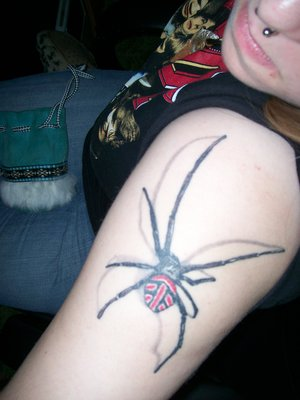 Girl With New 3D Spider Tattoo On Arm
