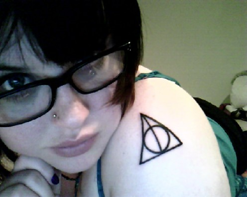 Gorgeous Black Ink Triangle Tattoo On Shoulder