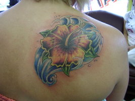 Gorgeous Blue Waves And Flower Tattoos For Women