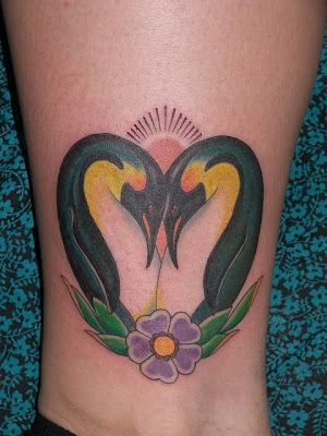 Gorgeous Penguin Love In Front Of Sun Tattoo