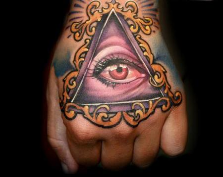 Gorgeous Pink Eye Triangle Tattoo On Hand