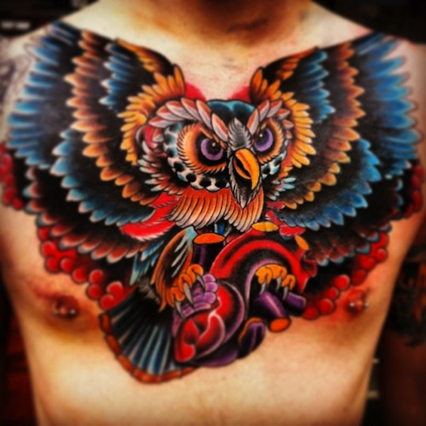 Great Color Owl With Heart Tattoo On Chest