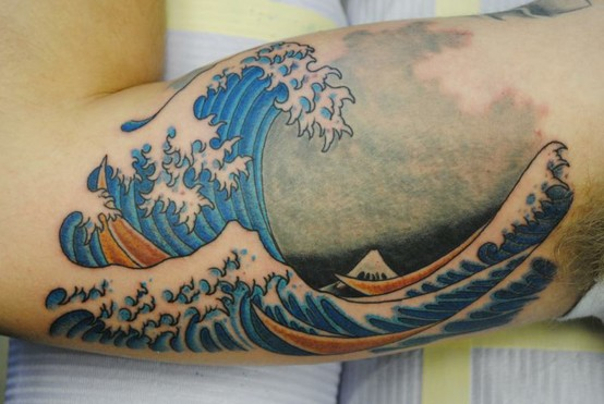 Great Japanese Wave Tattoo On Biceps