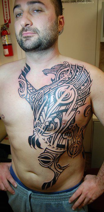 Great Large Polynesian Lion Tattoo On Upperbody