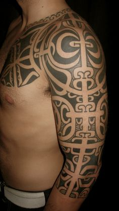 Great Polynesian Tattoos On Chest And Left Sleeve