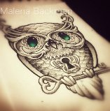 Green Jewel Eye On Key Tattoo Design