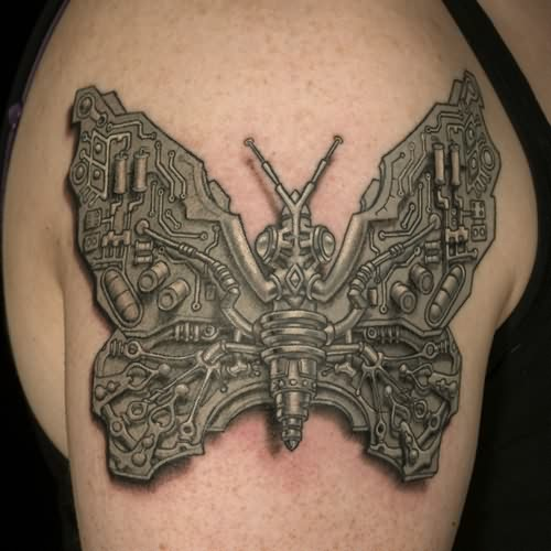 Grey 3D Biomech Butterfly Tattoo On Shoulder