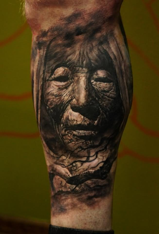 Grey 3D Old Woman Face Portrait Tattoo On Leg