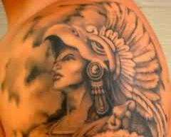 Grey Ink Aztec Warrior Tattoo On Shoulder