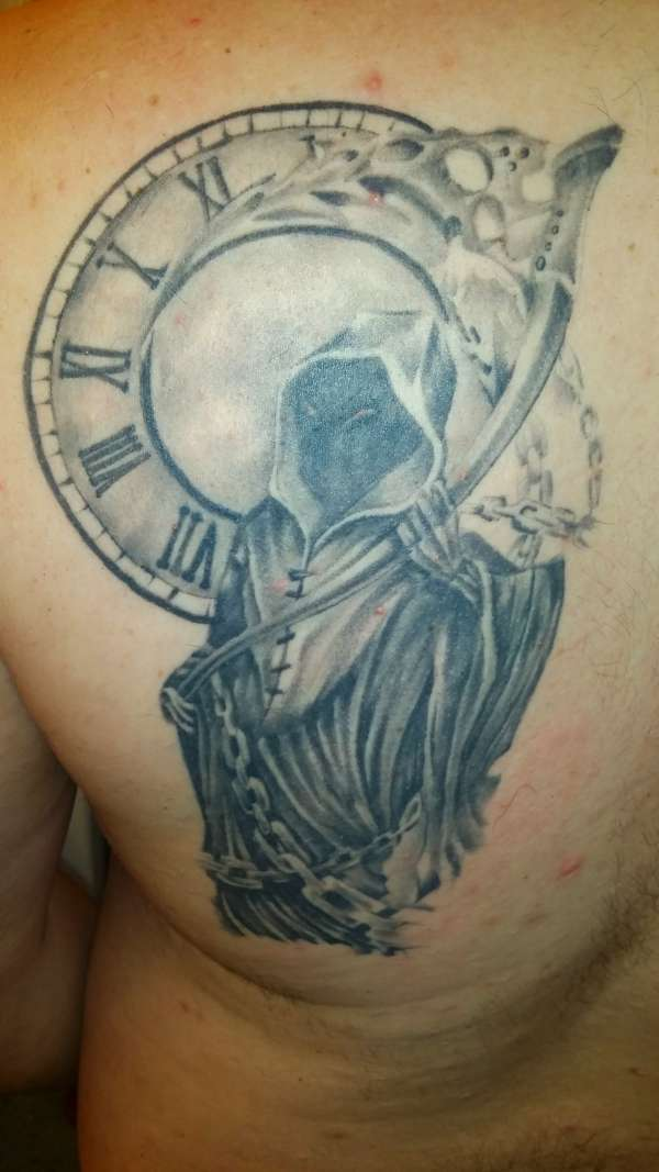 Grey Ink Clock And Grim Reaper Tattoos On Chest