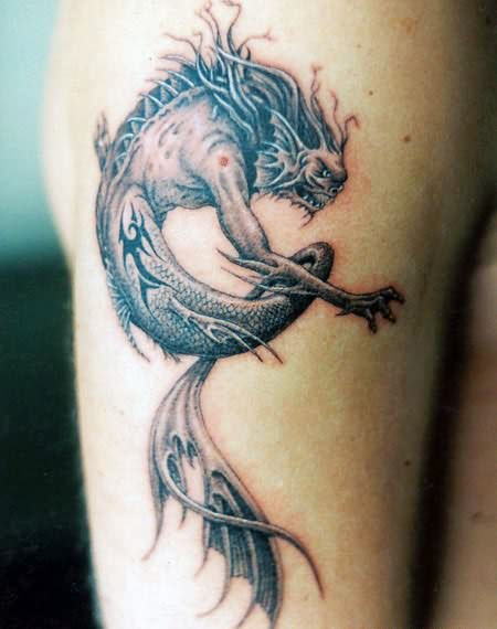 Grey Ink Dragon Seahorse Tattoo On Arm