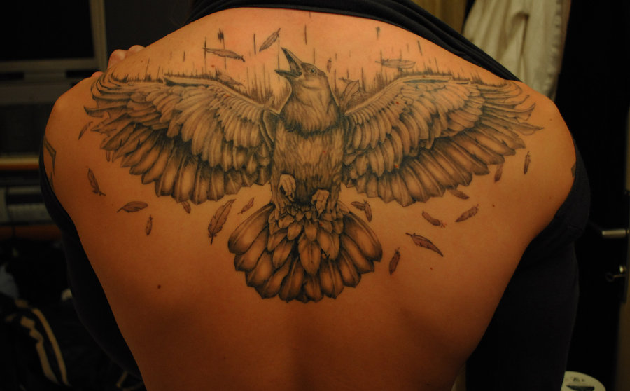 Grey Ink Open Wings Crow Tattoo On Upperback