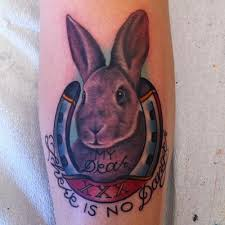 Grey Ink Rabbit And Horseshoe Tattoos