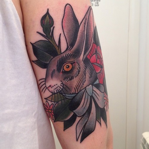 Grey Ink Rabbit With Bow Tattoo On Arm