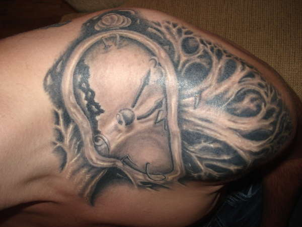 Grey Ink Salvador Dali Clock Tattoo On Top Of Shoulder