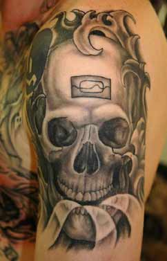 Grey Ink Skull Waves Tattoo On Shoulder