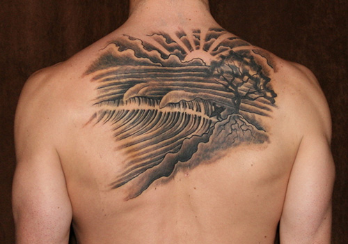 Grey Ink Sunset Wave Tattoos On Upperback
