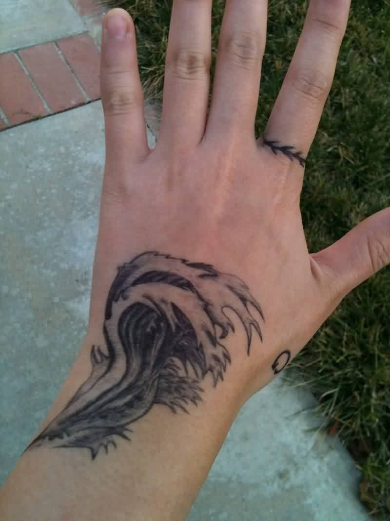 Grey Ink Tidal Wave Tattoo On Hand