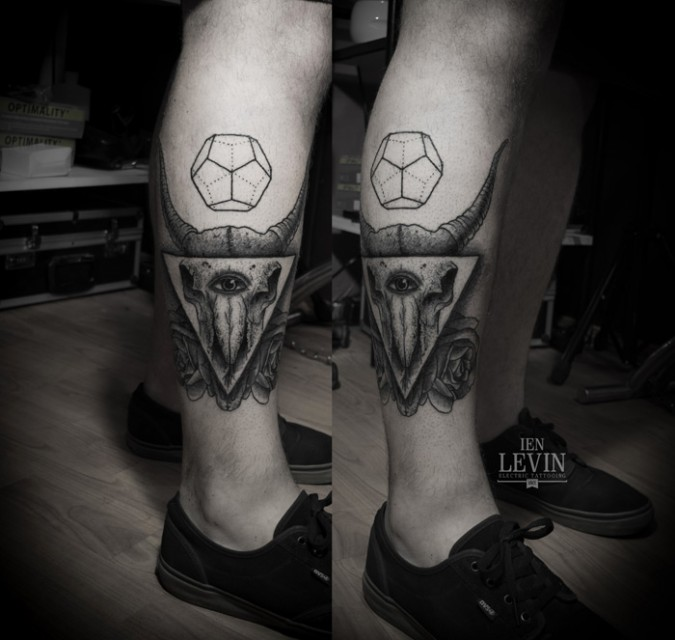 Grey Ink Triangle And Animal Skull Tattoos On Leg