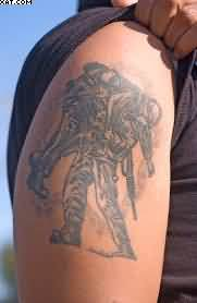 Grey Ink Warrior Tattoo On Biceps