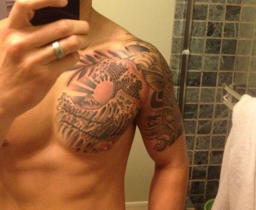 Grey Ink Wave Sun Tattoo On Chest