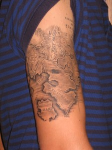Grey Maps Tattoos On Arm For Boys
