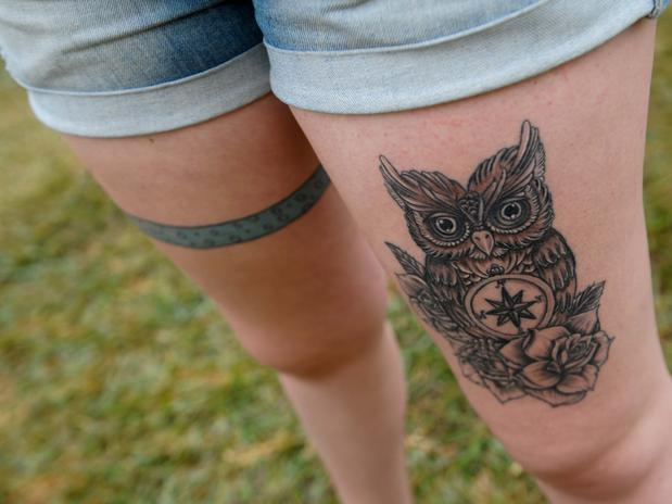 Grey Owl And Rose Tattoos On Thigh