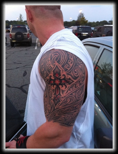 Grey Polynesian And Tribal Cross Tattoos On Half Sleeve