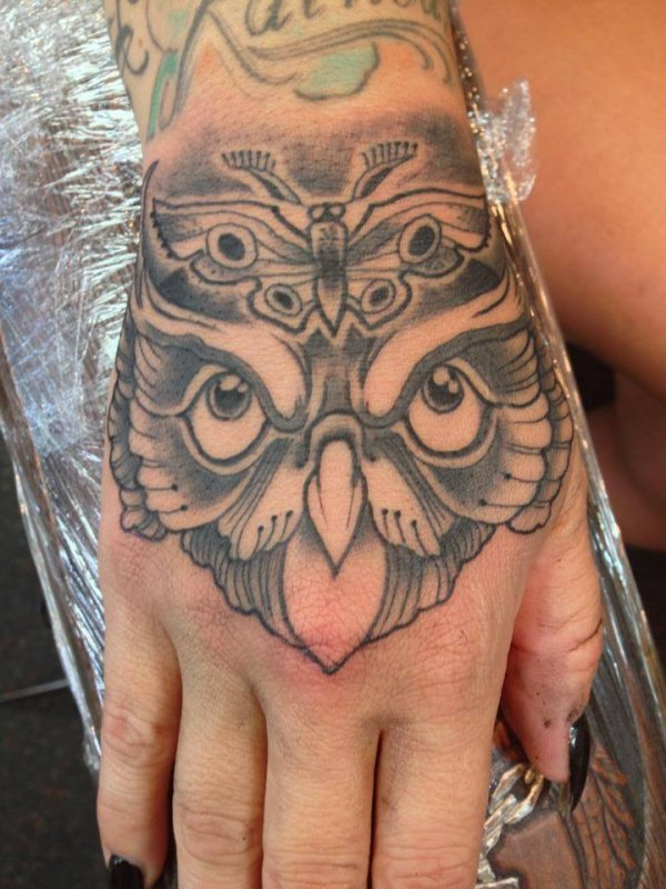 Grey Realistic Owl Head Tattoo On Hand